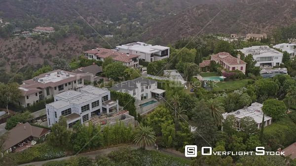 Los Angeles Panning around hillside mansions moving close up