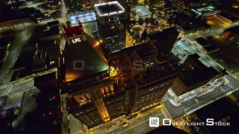North Carolina Greensboro Aerial Panning around overtop tall buildings with detail view to cityscape at night