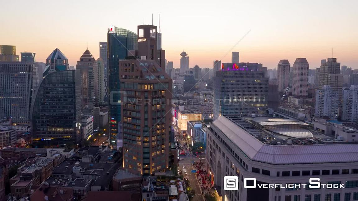 China Shanghai Aerial Hyperlapse at dusk, flying over cityscape to riverfront view
