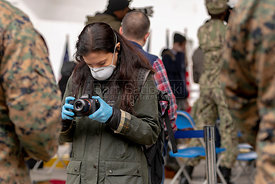 March 30. 2020 - New York, New York - Reporter photographing Soldier at the site where the 1,000-bed floating hospital USNS C...