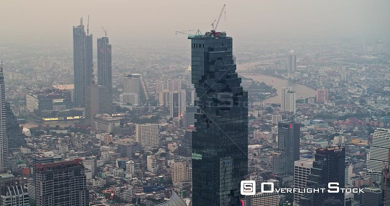 Thailand Bangkok Aerial Panning away from MahaNakhon Tower with cityscape view