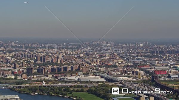 NYC New York Panoramic view stretching Queens, The Bronx, and Upper Manhattan with airplanes