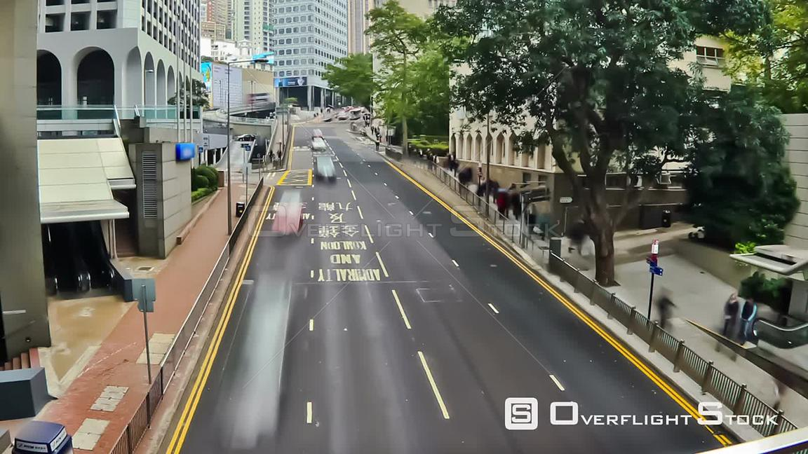 City pedestrian traffic time lapse of elevated walkway in Hong Kong.