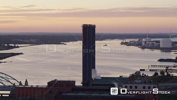 Providence Rhode Island Low vantage panning view of industrial cityscape with power station & wind turbines