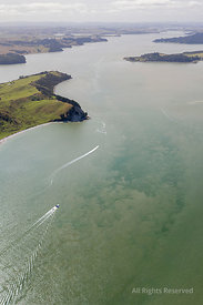 Aerial View on Kaipara Harbour Owith a Motorboat on Clear Water in Northland, New Zealand. the Landscape Shows Some Coastline...