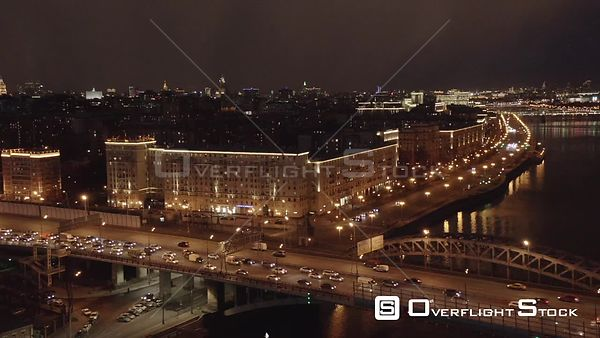 Night Sideway Flight Over Moscow River, With Night Cityscape. Moscow Russia Drone Video View