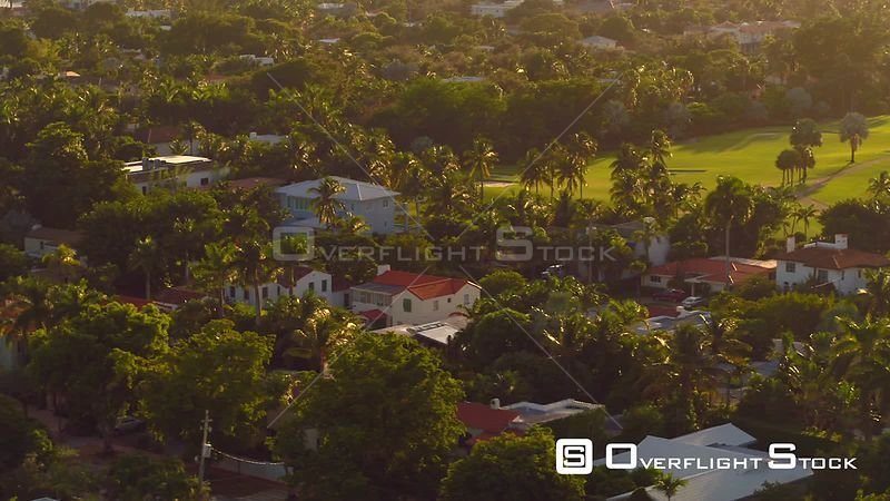Aerial drone video upscale neighborhood palm trees and mansions 4k