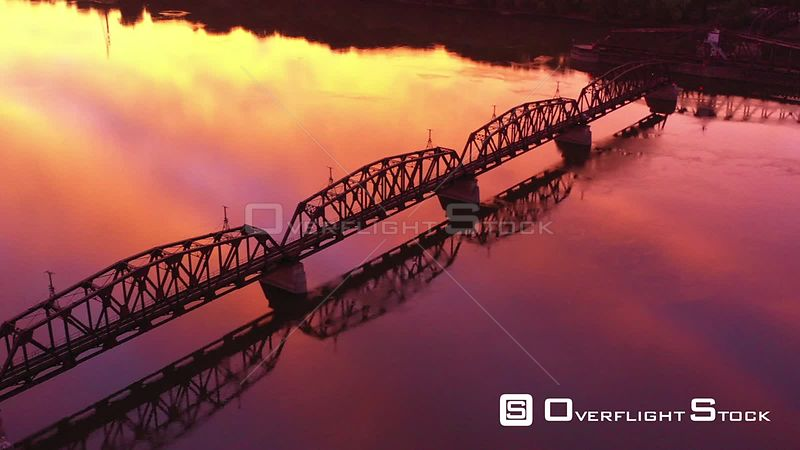 Railroad Bridge and a Towboat with Early Morning Reflections, Dubuque, Iowa, USA