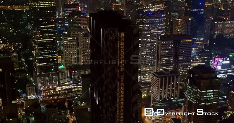 Thailand Bangkok Aerial Slow birdseye cityscape night view moving in reverse