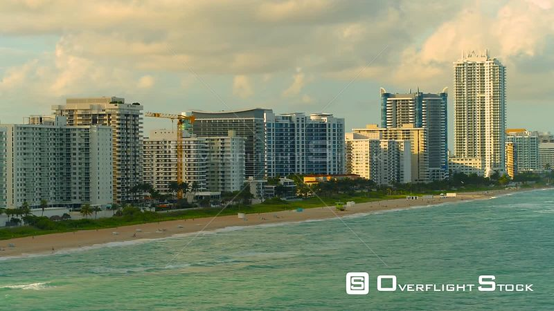 Aerial Miami Beach scene shot over ocean 4k