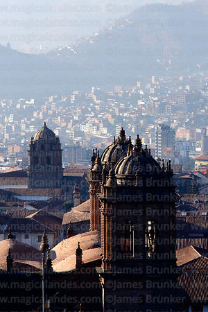 Rooftop view of towers of cathedral (R) and Santo Domingo church in background, Cusco, Peru