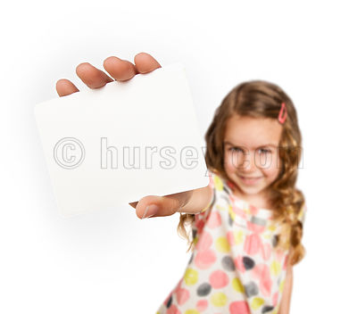 Girl holding a blank card close to camera