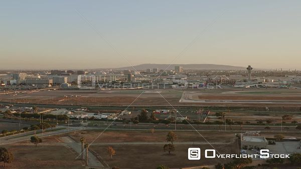 Los Angeles Slow panning airport cityscape at sunset with ocean view