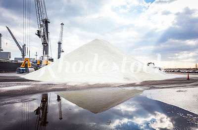 A Tall Pile of Road Salt in Front of a Cargo Ship