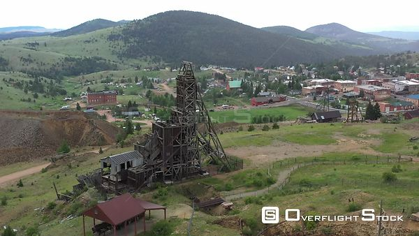 Abandoned mine shaft head structure, and small town, Victor, Colorado, USA