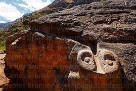 Detail of carved snake head at end of water channel on large boulder or huaca at Inca site of Urco / Unu Urqo, near Calca, Cu...