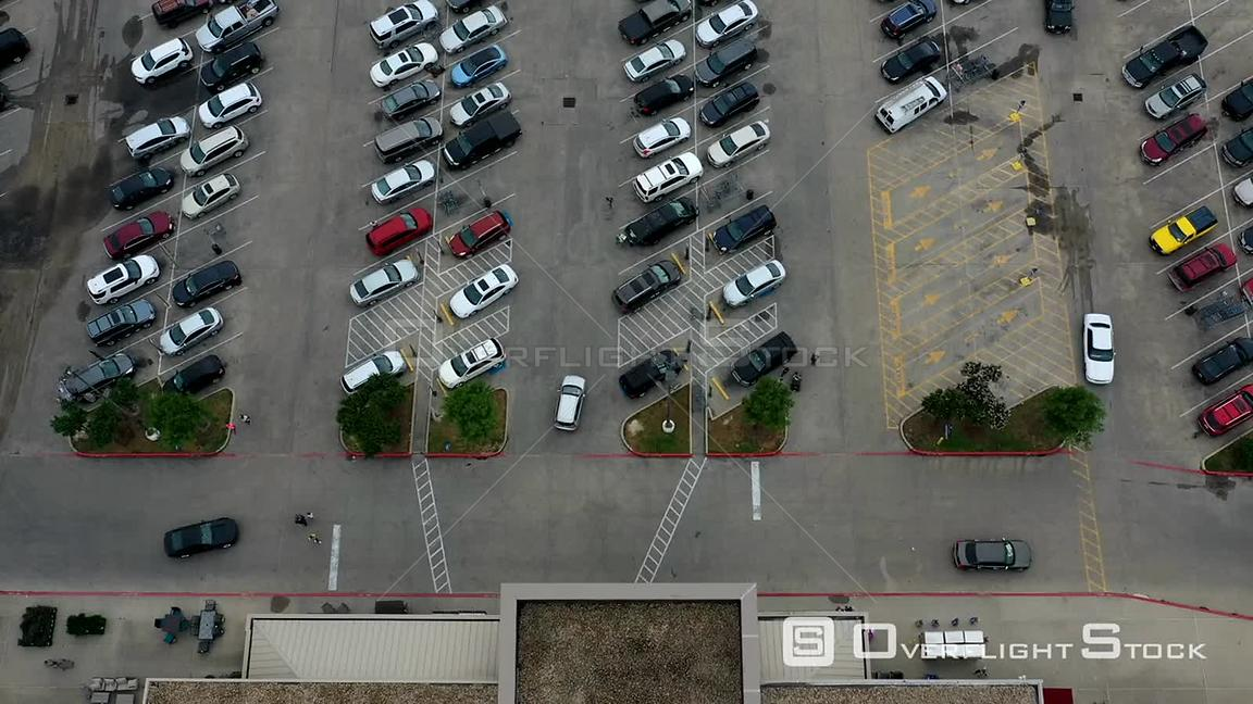 Timelapse of cars and people in a grocery store parking lot, Bryan, Texas, USA