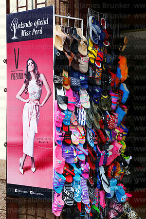 Banner of Miss Peru outside shop selling flip-flops, Cusco, Peru