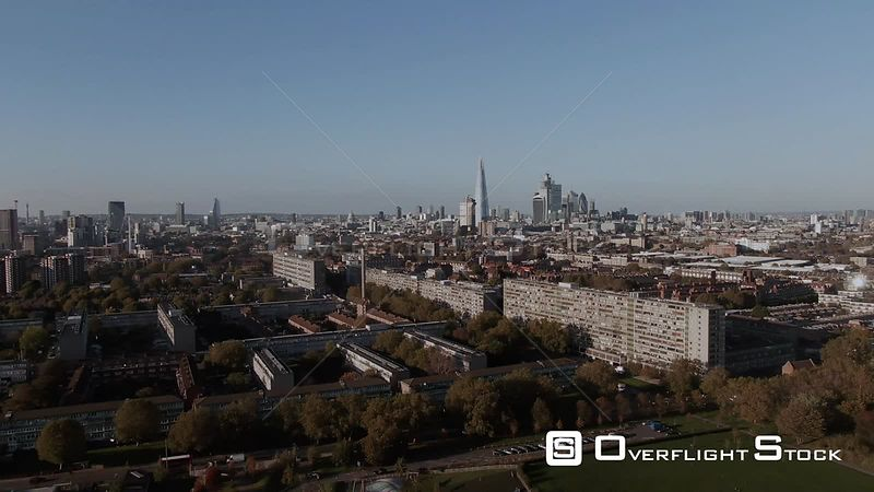 Aerial dolly view of the skyline of the City of London from the South