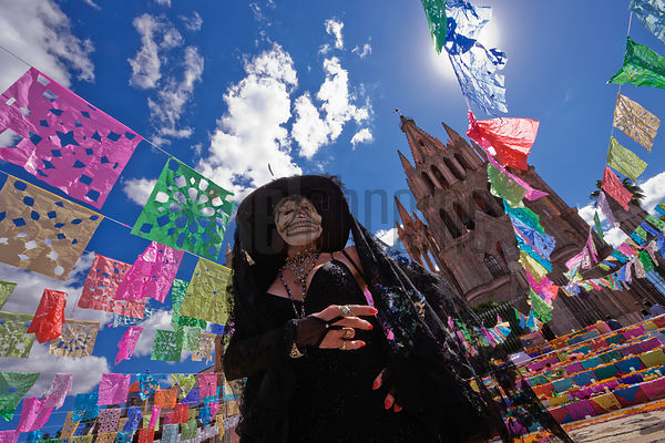 Woman dressed up for Day of the Dead in front of the Parroquia San Miguel de Allende Mexico