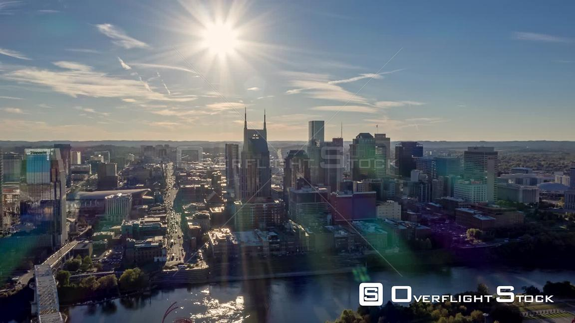 Tennessee Nashville Aerial Cityscape hyperlapse passing over river and downtown into sun
