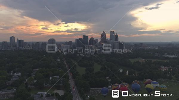 Atlanta Midtown skyline sunset, dusk fly through view from hot air balloon filled Piedmont park to Atlantic Station