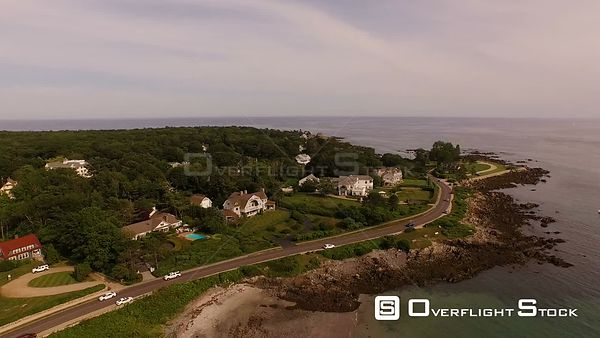 Flying low over coastline homes and Kennebunkport panning. Maine