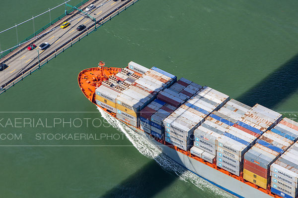 Container Ship passing under Lions Gate Bridge