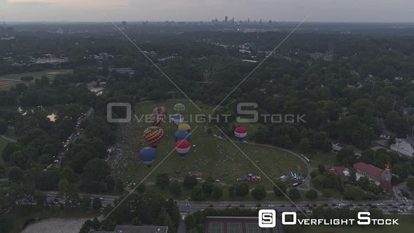Atlanta Panning over scenic hot air balloon filled Piedmont park with Buckhead skyline at dusk
