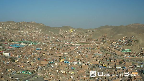 Ventanilla  Peru  Flying low over urban poverty hillside housing area panning in Mi Peru.