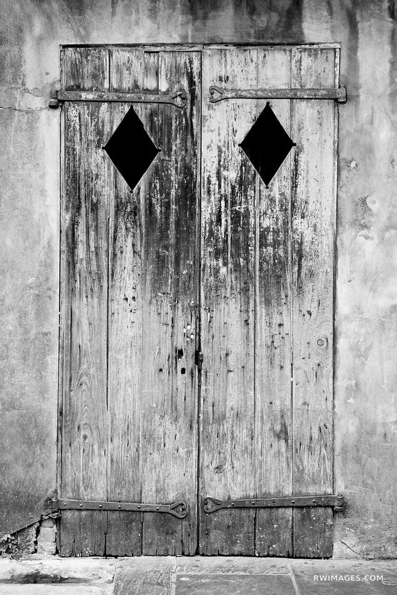 OLD WOODEN DOOR FRENCH QUARTER NEW ORLEANS BLACK AND WHITE VERTICAL