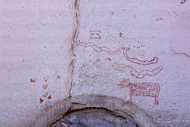 Detail of rock paintings of symbols and an animal at Tomas Laq`A site near Villa Mar, Potosí Department, Bolivia