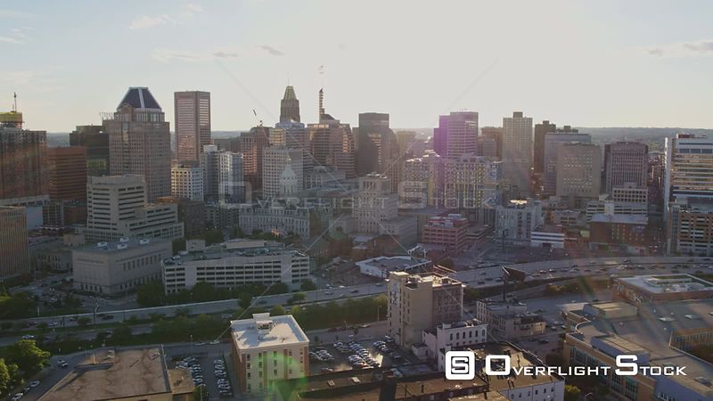 Baltimore Maryland Aerial Panning view of downtown cityscape with sunlight and freeway traffic
