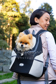 Young Asian Woman with Dog in Backpack