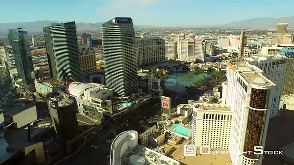 Low flying backwards aerial over strip Las Vegas Nevada
