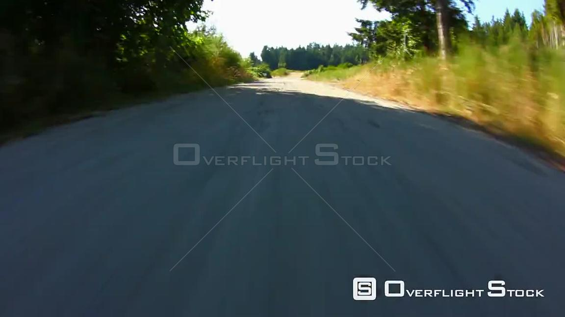 Country driving on gravel road using a fisheye lens 8 inches from ground.