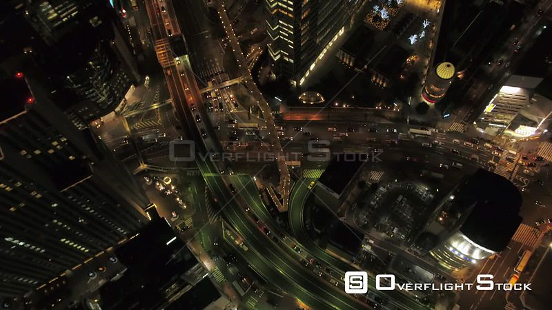 Japan Tokyo Aerial Shinjuku birdseye view flying panning up to downtown cityscape dusk