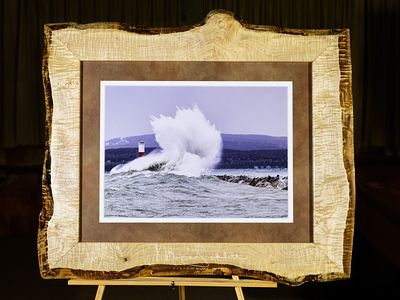 Wood_frame_Petoskey_Lighthouse_crashing_wave._0365