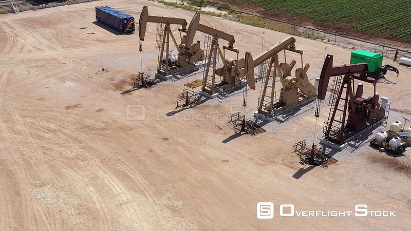 Pumping oil with 4 pumpjacks, Brazos County, Texas, USA