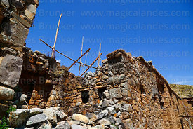 Reconstruction work on south wall of Inca temple of Iñak Uyu, Moon Island, Lake Titicaca, Bolivia