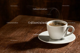 Coffee cup isolated on rustic wood background.