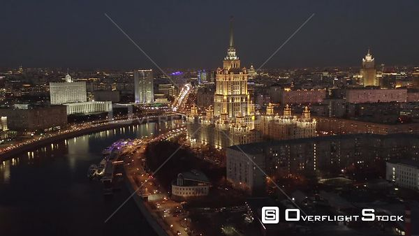 Night Backwardflight Over Moscow Riverbank and Historical Building of Radisson Sas Hotel With City Lights. Moscow Russia Dron...