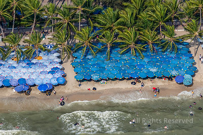 Crowded Holiday Tourist Beachs with Umbrellas Thailand