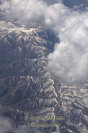 Aerial view of clouds and snowy hills, Utah, USA