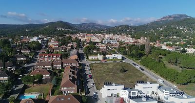 Residential area with semidetached houses and mountains in the background. Matadepera Spain