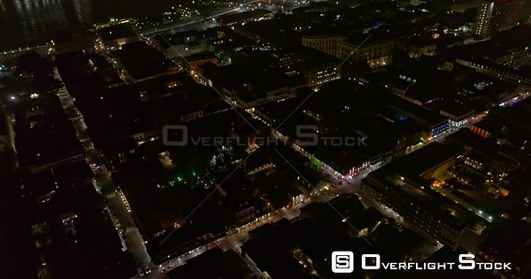 New Orleans Louisiana Aerial Nighttime panning to vertical view of French Quarter