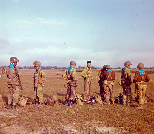 ARVN soldiers waiting to board helicopters for combat assault, Tuy Hoa RVN.  US Army combat aviation operations in Viet Nam