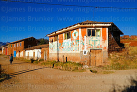 Colourful houses and old Perú Posible party election propaganda, Racchi, near Chinchero, Cusco Region, Peru