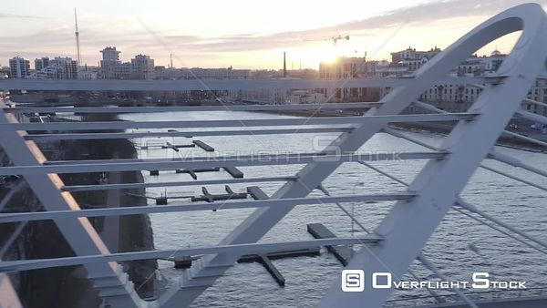 Sideway Shot at Sunrise of New Bridge in New District of a City. Saint Petersburg Russia Drone Video View