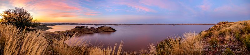 Sunrise over the calm waters of Hardap Dam, Southern Namibia